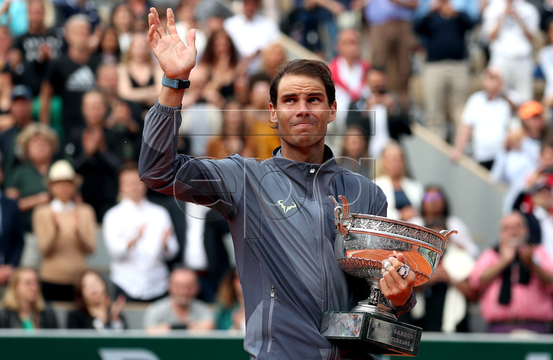 Rafael Nadal of Spain poses with the trophy after winning the men?s final match against Dominic Thiem of Austria during the French Open tennis tournament at Roland Garros in Paris, France, 09 June 2019. Nadal won the French Open title 12th times. EPA-EFE/SRDJAN SUKI