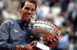 Rafael Nadal of Spain poses with the trophy after winning the men?s final match against Dominic Thiem of Austria during the French Open tennis tournament at Roland Garros in Paris, France, 09 June 2019. Nadal won the French Open title 12th times. EPA-EFE/YOAN VALAT