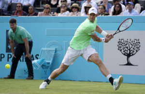 South Africa's Kevin Anderson returns to Britain's Cameron Norrie during their round 32 match at the Fever Tree Championship at Queen's Club in London, Britain, 17 June 2019. The tournament runs from 17th June till 23 June 2019. EPA-EFE/WILL OLIVER