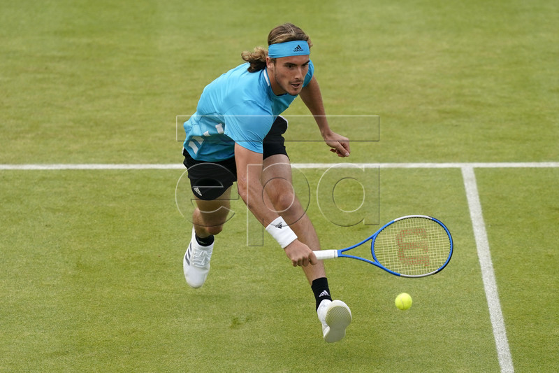 Stefanos Tsitsipas of Greece returns to Britain's Kyle Edmund during their round 32 match at the Fever Tree Championship at Queen's Club in London, Britain, 19 June 2019. EPA-EFE/WILL OLIVER