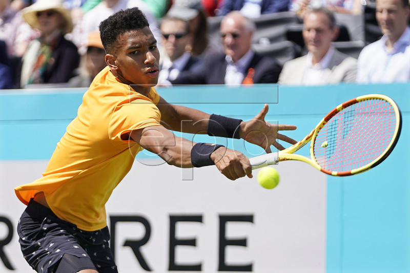 Canada's Felix Auger Aliassime in action against Greece's Stefanos Tsitsipas during their quarter final match at the Fever Tree Championship at Queen's Club in London, Britain, 21 June 2019. EPA-EFE/WILL OLIVER