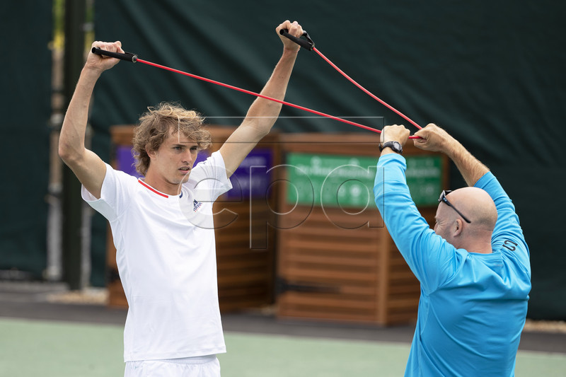 Alexander Zverev (L) of Germany attends a training session at the All England Lawn Tennis Championships in Wimbledon, London, Britain, 26 June 2019. The Wimbledon Tennis Championships 2019 will be held in London from 01 July to 14 July 2019. EPA-EFE/PETER KLAUNZER EDITORIAL USE ONLY/NO SALES/NO ARCHIVES