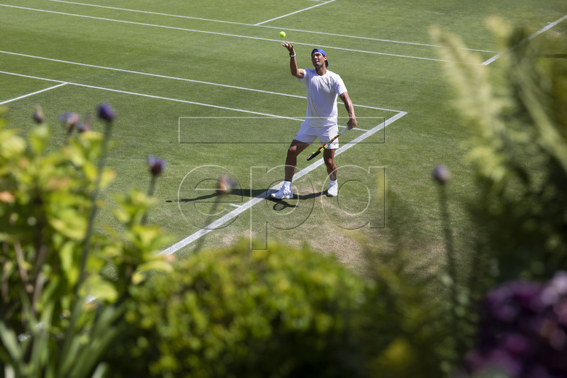 Rafael Nadal of Spain serves during a training session at the All England Lawn Tennis Championships in Wimbledon, London, on Thursday, June 27, 2019. EPA-EFE/PETER KLAUNZER EDITORIAL USE ONLY; NO SALES, NO ARCHIVES