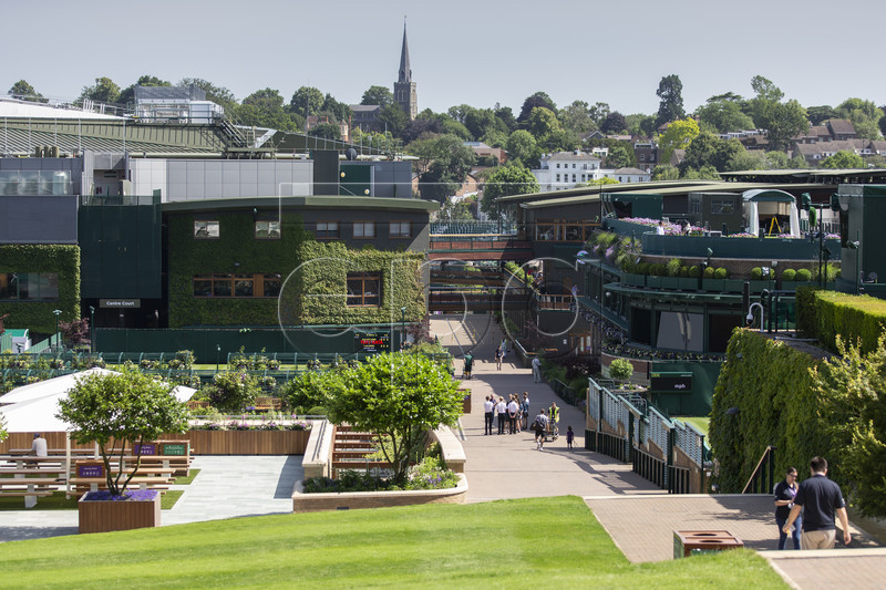 General view with the centre court, left, and the church, back, at the All England Lawn Tennis Championships in Wimbledon, London, on Thursday, June 27, 2019. The Wimbledon Tennis Championships 2019 will be held in London from 1 July to 14 July. EPA-EFE/PETER KLAUNZER EDITORIAL USE ONLY; NO SALES, NO ARCHIVES