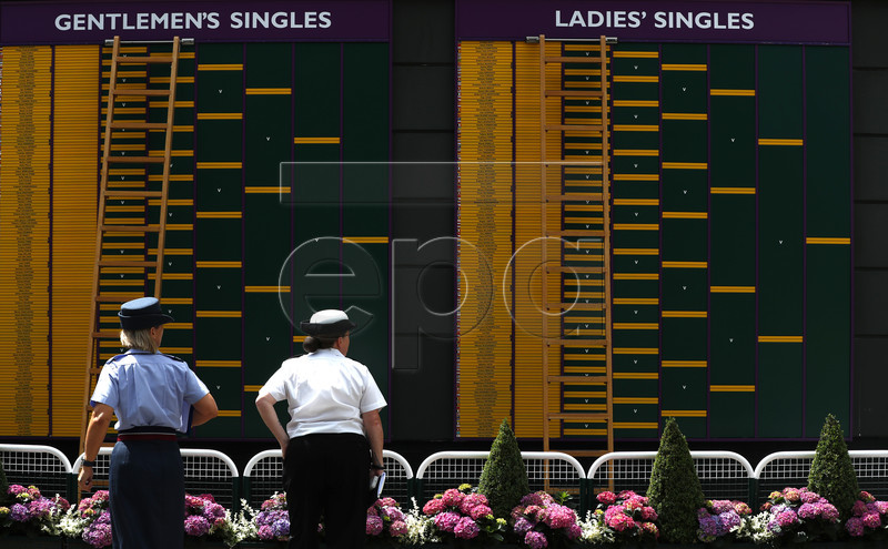 Security personell on duty in preparation for the Wimbledon Championships at the All England Lawn Tennis Club, in London, Britain, 30 June 2019. EPA-EFE/NIC BOTHMA EDITORIAL USE ONLY/NO COMMERCIAL SALES