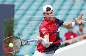 John Isner of the US in action against Roger Federer of Switzerland during their Men's finals match at the Miami Open tennis tournament in Miami, Florida, USA, 31 March 2019. EPA-EFE/RHONA WISE