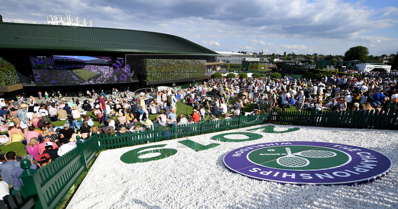 Spectators watch first round action on Aorangi Terrace at the Wimbledon Championships at the All England Lawn Tennis Club, in London, Britain, 02 July 2019. EPA-EFE/ANDY RAIN EDITORIAL USE ONLY/NO COMMERCIAL SALES