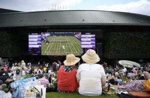 Spectators follow the action on the big screen on day three of the Wimbledon Championships at the All England Lawn Tennis Club, in London, Britain, 03 July 2019. EPA-EFE/ANDY RAIN EDITORIAL USE ONLY/NO COMMERCIAL SALES