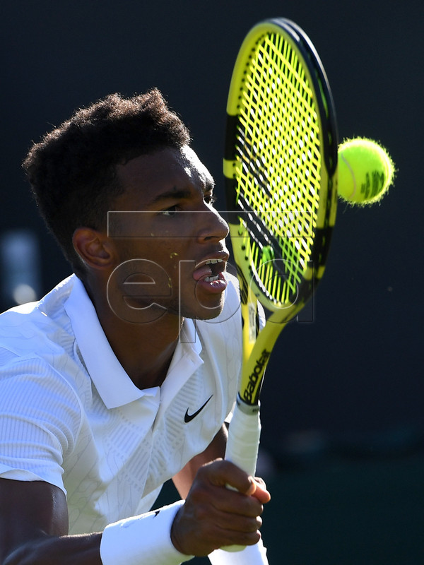 Felix Auger Aliassime from Canada in action against Corentin Moutet of France during their second round match at the Wimbledon Championships at the All England Lawn Tennis Club, in London, Britain, 03 July 2019. EPA-EFE/FACUNDO ARRIZABALAGA EDITORIAL USE ONLY/NO COMMERCIAL SALES