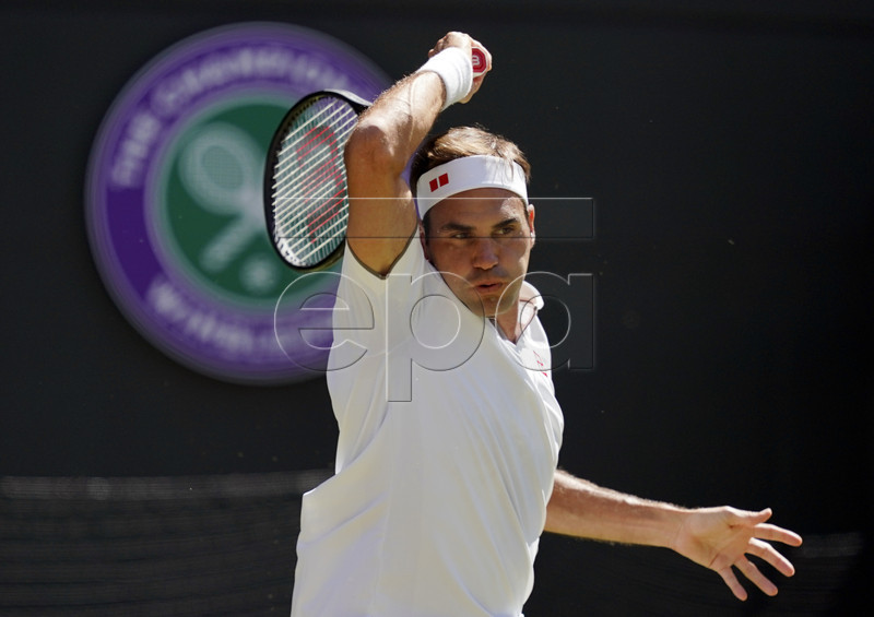 Roger Federer of Switzerland returns to Jay Clarke of Britain in their second round match during the Wimbledon Championships at the All England Lawn Tennis Club, in London, Britain, 04 July 2019. EPA-EFE/WILL OLIVER EDITORIAL USE ONLY/NO COMMERCIAL SALES
