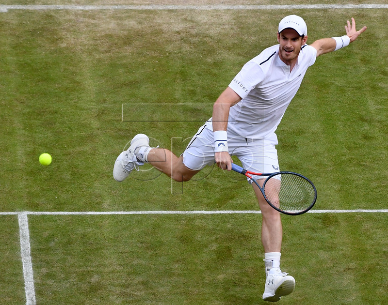 Andy Murray of Britain in action during his Men's Doubles match with Pierre-Hugues Herbert of France against Marius Copil of Romania und Ugo Humbert of France at the Wimbledon Championships at the All England Lawn Tennis Club, in London, Britain, 04 July 2019. EPA-EFE/ANDY RAIN EDITORIAL USE ONLY/NO COMMERCIAL SALES