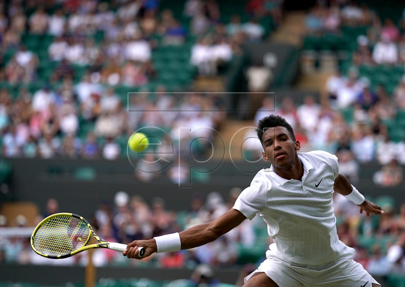 Felix Auger Aliassime from Canada in action against Ugo Humbert of France during their third round match at the Wimbledon Championships at the All England Lawn Tennis Club, in London, Britain, 05 July 2019. EPA-EFE/NIC BOTHMA EDITORIAL USE ONLY/NO COMMERCIAL SALES