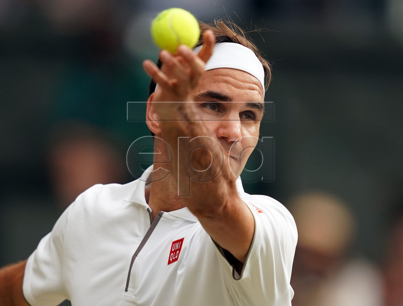 Roger Federer of Switzerland plays Lucas Pouille of France in their third round match during the Wimbledon Championships at the All England Lawn Tennis Club, in London, Britain, 06 July 2019. EPA-EFE/WILL OLIVER EDITORIAL USE ONLY/NO COMMERCIAL SALES