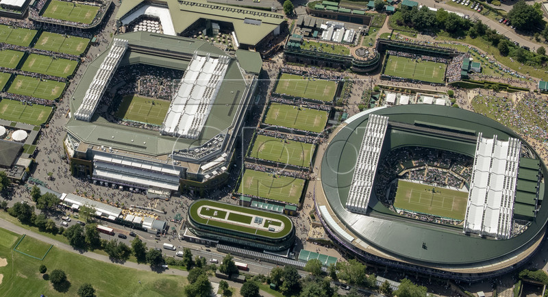 A handout photo made available by the AELTC on 08 July 2019 shows an aerial view from a helicopter of the The All England Lawn Tennis Club grounds in Wimbledon, London, Britain, 04 July 2019. EPA-EFE/AELTC/Thomas Lovelock EDITORIAL USE ONLY/NO COMMERCIAL SALES