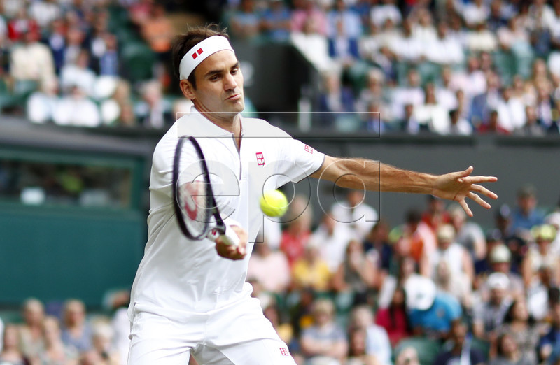Roger Federer of Switzerland returns to Matteo Berrettini of Italy in their fourth round match during the Wimbledon Championships at the All England Lawn Tennis Club, in London, Britain, 08 July 2019. EPA-EFE/NIC BOTHMA EDITORIAL USE ONLY/NO COMMERCIAL SALES