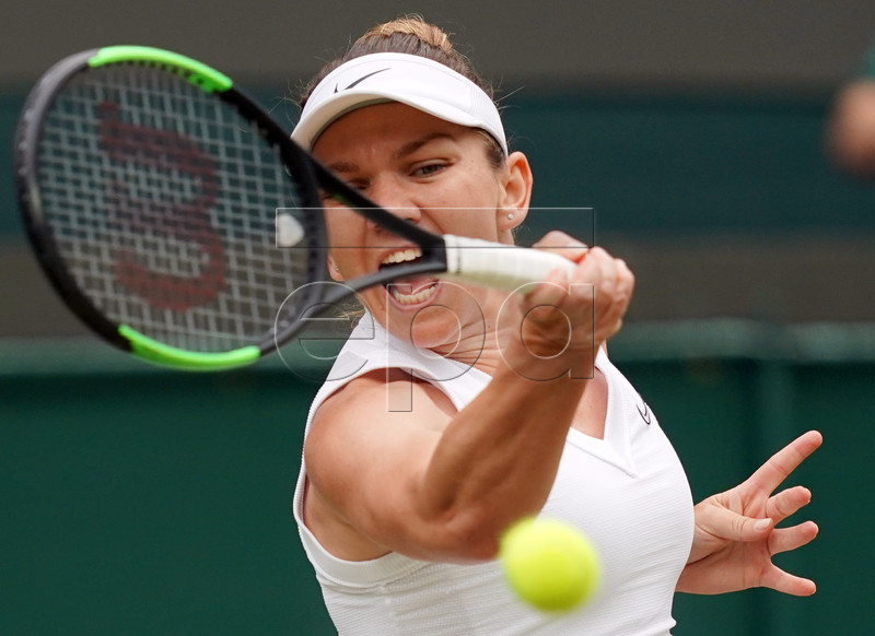 Simona Halep of Romania returns to Shuai Zhang of China in their quarter final match during the Wimbledon Championships at the All England Lawn Tennis Club, in London, Britain, 09 July 2019. EPA-EFE/WILL OLIVER EDITORIAL USE ONLY/NO COMMERCIAL SALES