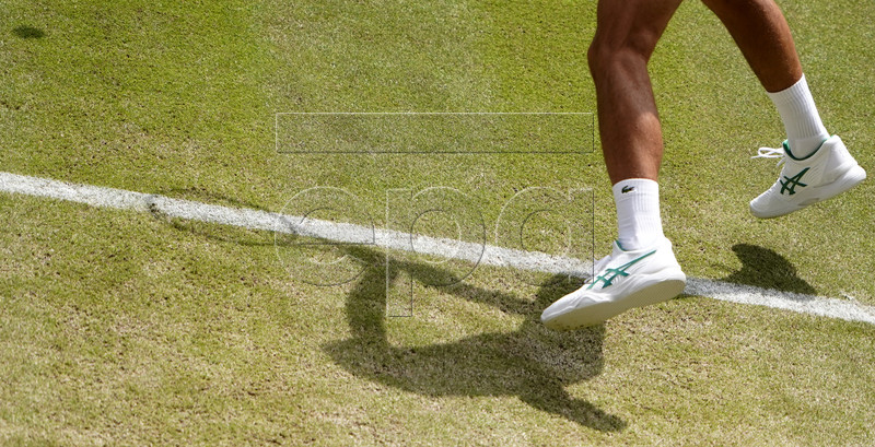 Novak Djokovic of Serbia in action against David Goffin of Belgium during their quarter final match for the Wimbledon Championships at the All England Lawn Tennis Club, in London, Britain, 10 July 2019. EPA-EFE/NIC BOTHMA EDITORIAL USE ONLY/NO COMMERCIAL SALES