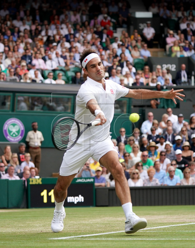 Roger Federer of Switzerland in action against Kei Nishikori of Japan during their quarter final match for the Wimbledon Championships at the All England Lawn Tennis Club, in London, Britain, 10 July 2019. EPA-EFE/NIC BOTHMA EDITORIAL USE ONLY/NO COMMERCIAL SALES