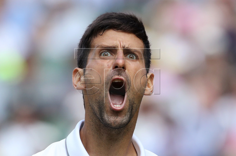Novak Djokovic of Serbia in action against Roberto Bautista Agut of Spain during their semi final match for the Wimbledon Championships at the All England Lawn Tennis Club, in London, Britain, 12 July 2019. EPA-EFE/CARL RECINE / POOL EDITORIAL USE ONLY/NO COMMERCIAL SALES