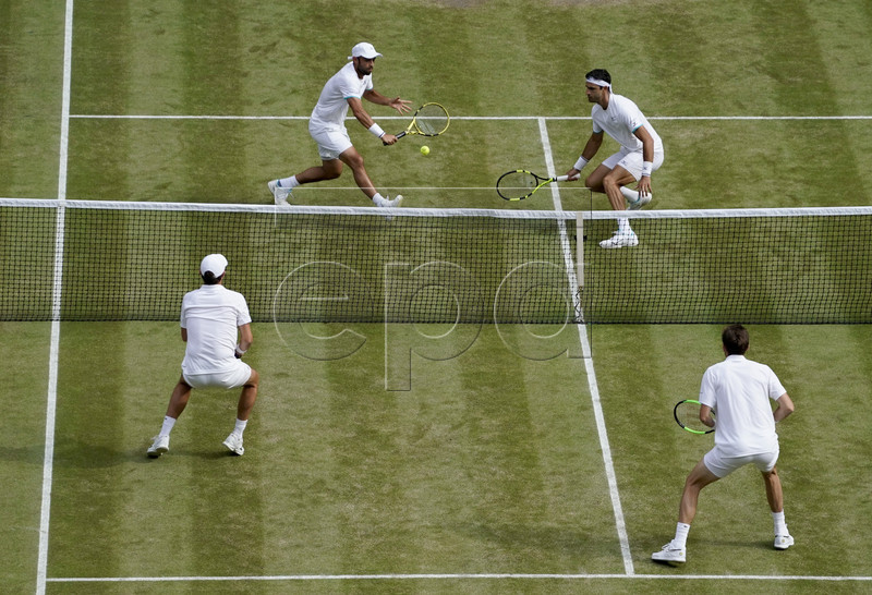 Juan Sebastian Cabal (up L) of Colombia and Robert Farah (up R) of Colombia in action against Nicolas Mahut of France and Edouard Roger-Vasselin of France during their Men's Doubles final match for the Wimbledon Championships at the All England Lawn Tennis Club, in London, Britain, 13 July 2019. EPA-EFE/WILL OLIVER EDITORIAL USE ONLY/NO COMMERCIAL SALES
