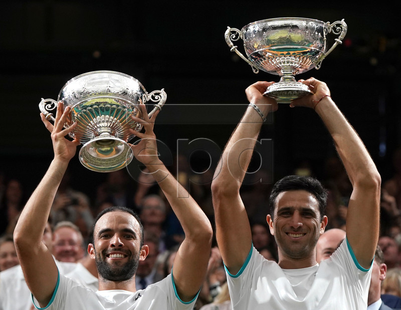 Juan Sebastian Cabal (L) of Colombia and Robert Farah (R) of Colombia celebrate with the trophy after winning against Nicolas Mahut of France and Edouard Roger-Vasselin of France during their Men's Doubles final match for the Wimbledon Championships at the All England Lawn Tennis Club, in London, Britain, 13 July 2019. EPA-EFE/NIC BOTHMA EDITORIAL USE ONLY/NO COMMERCIAL SALES