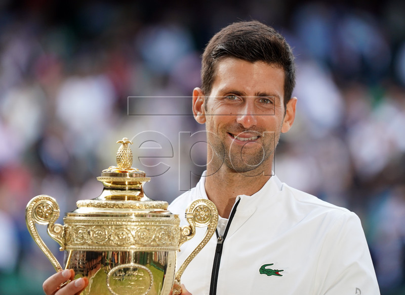 Novak Djokovic of Serbia with the championship trophy after defeating Roger Federer of Switzerland in the men's final of the Wimbledon Championships at the All England Lawn Tennis Club, in London, Britain, 14 July 2019. EPA-EFE/NIC BOTHMA EDITORIAL USE ONLY/NO COMMERCIAL SALES