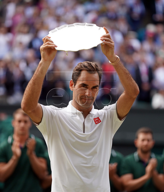 Roger Federer of Switzerland with the runner-up trophy following his loss to Novak Djokovic of Serbia in the men's final of the Wimbledon Championships at the All England Lawn Tennis Club, in London, Britain, 14 July 2019. EPA-EFE/NIC BOTHMA EDITORIAL USE ONLY/NO COMMERCIAL SALES