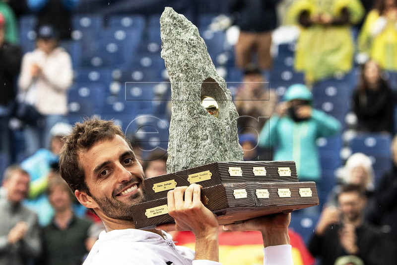 Albert Ramos-Vinolas of Spain poses with the trophy after defeating Cedrik-Marcel Stebe of Germany in their final match of the Swiss Open tennis tournament in Gstaad, Switzerland, 28 July 2019. EPA-EFE/PETER SCHNEIDER