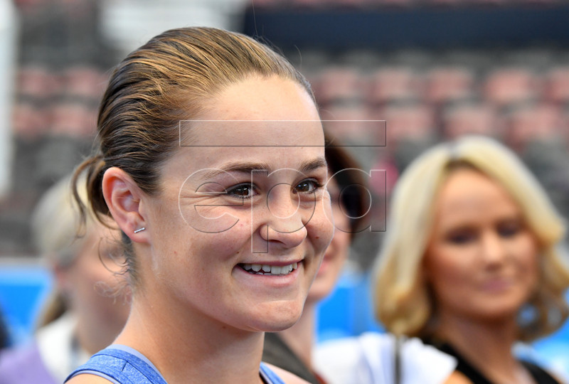 French Open winner and world number one tennis player Ashleigh Barty (C) smiled during a welcome home event at Pat Rafter Arena in Brisbane, Australia, 25 July 2019. Queensland Premier Annastacia Palaszczuk and 70 junior tennis players officially welcomed home Ashleigh Barty to Australia after her recent French Open win. EPA-EFE/DARREN ENGLAND AUSTRALIA AND NEW ZEALAND OUT